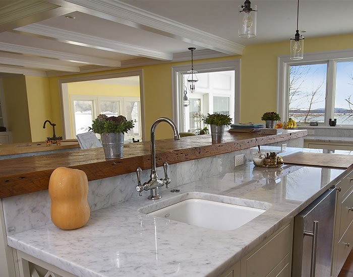 White Carrara Marble Countertops In Modern Kitchen