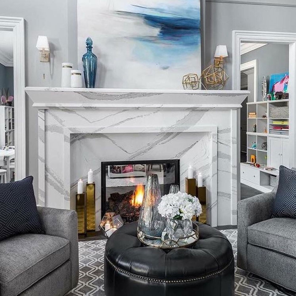 warm up to an elegant white and gray fireplace surround by cambria